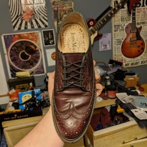 Brown wingtip dress shoes